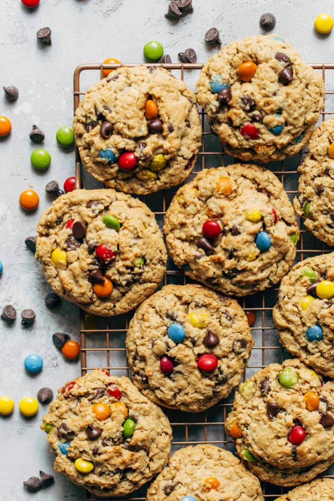 a cooling rack covered in monster cookies