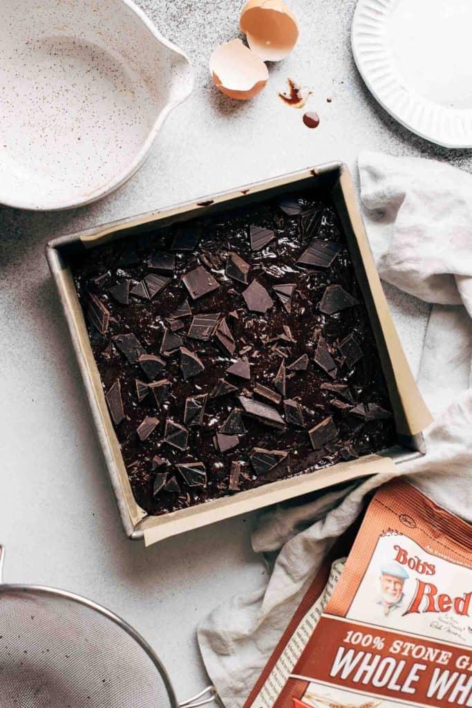 dark chocolate brownie batter in a baking pan