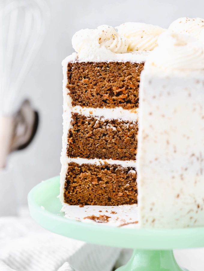 a slice taken out of a perfect carrot cake