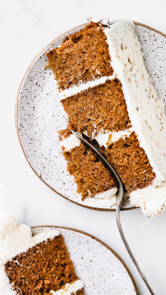 a slice of carrot cake made from scratch
