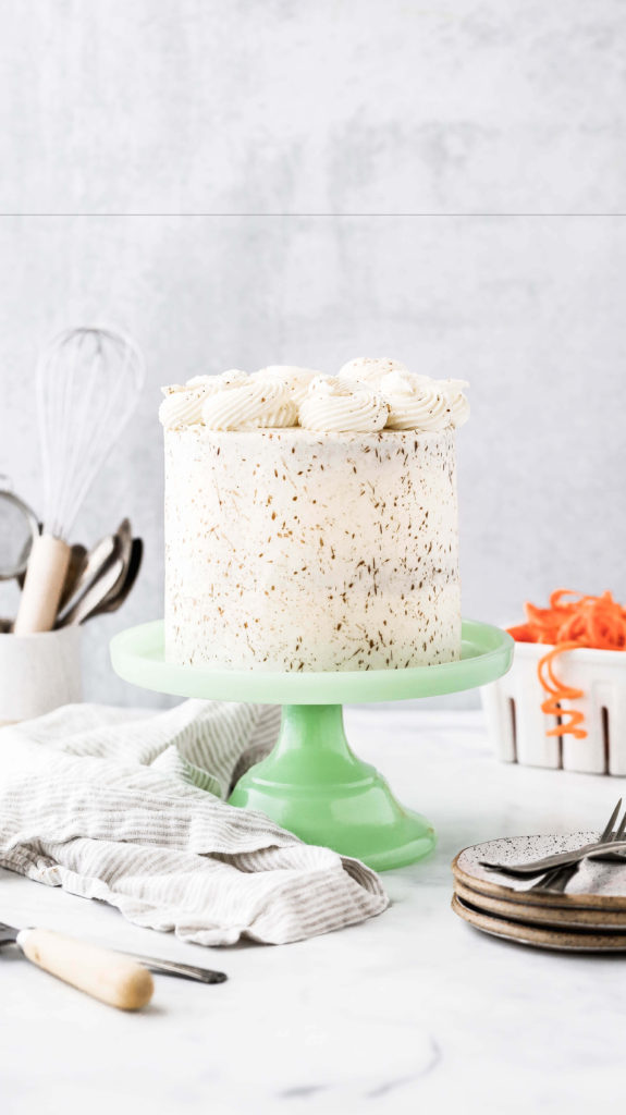 a layer carrot cake on a green cake stand