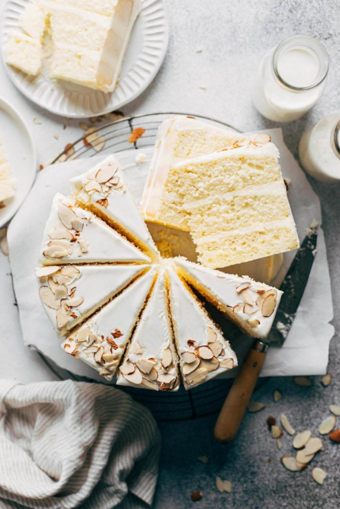 the top view of a sliced almond layer cake