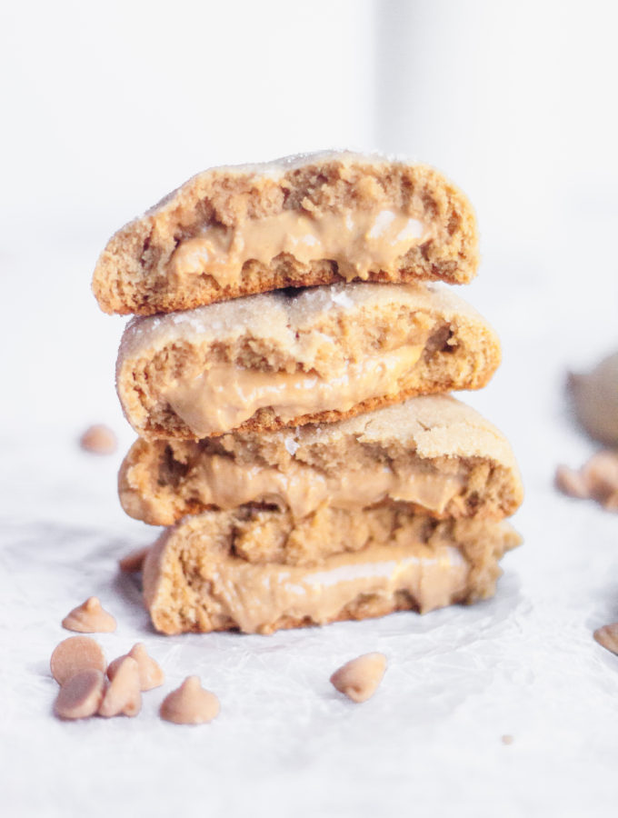 peanut butter cookies stuffed with peanut butter and stacked on top of each other