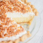 caramel coconut cream pie with a slice taken out