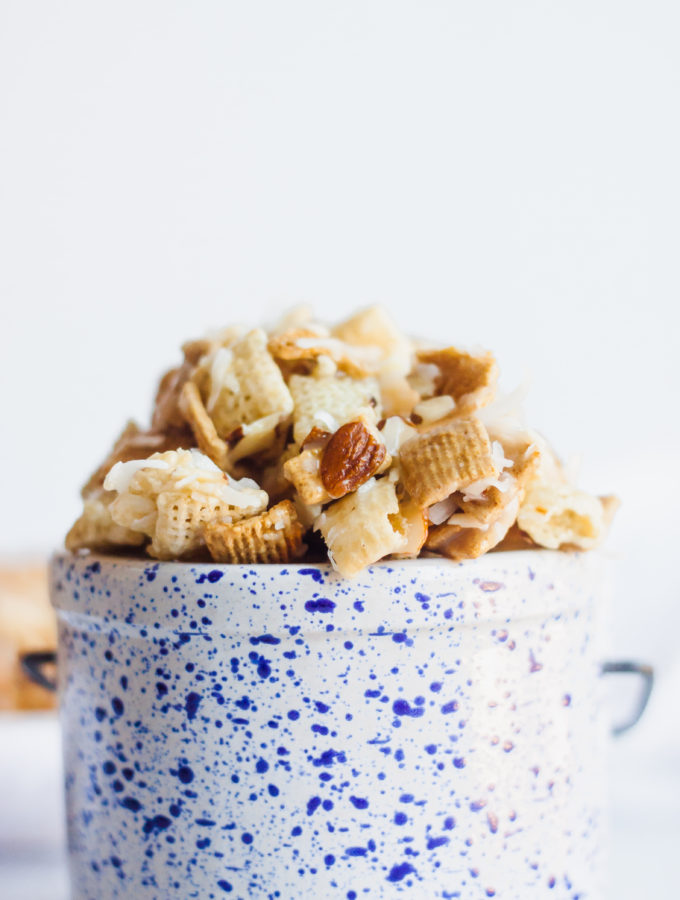 Coconut almond crunch in a tiny blue speckled crock