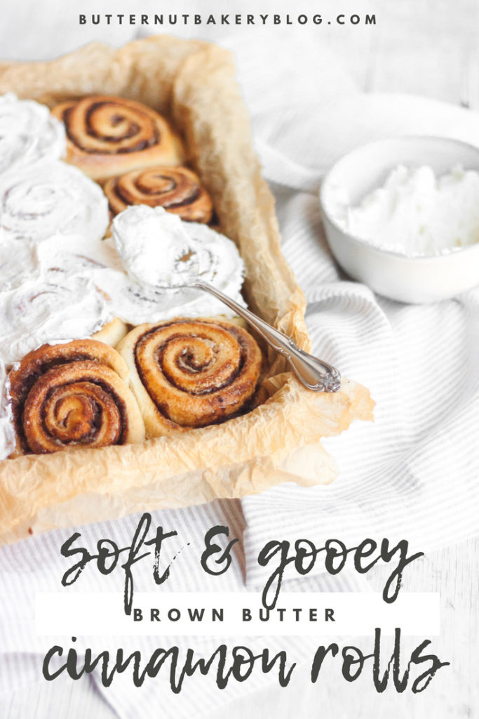 Cinnamon rolls in a tray with cream cheese frosting