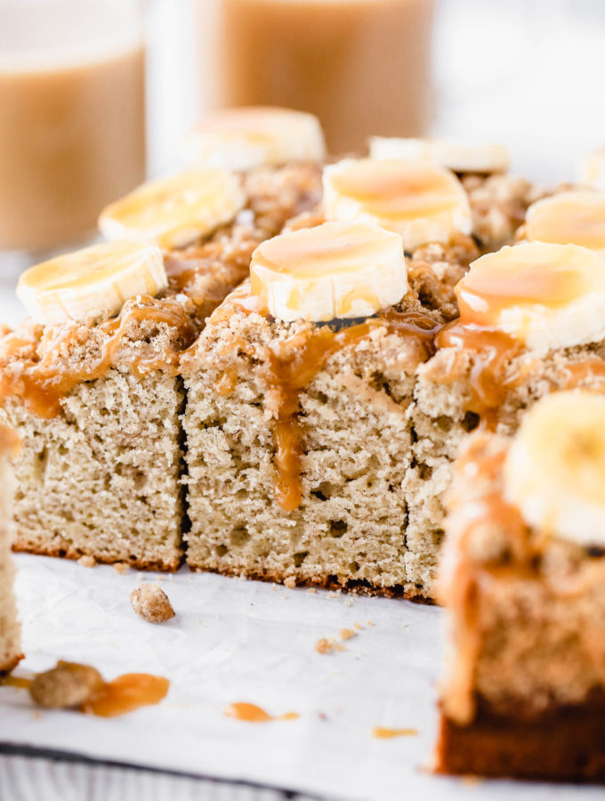 caramel dripping down a slice of banana coffee cake