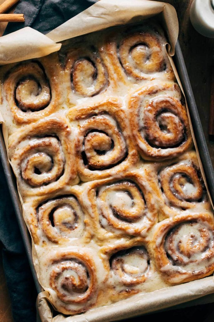 the top of cinnamon rolls that have been smothered in icing
