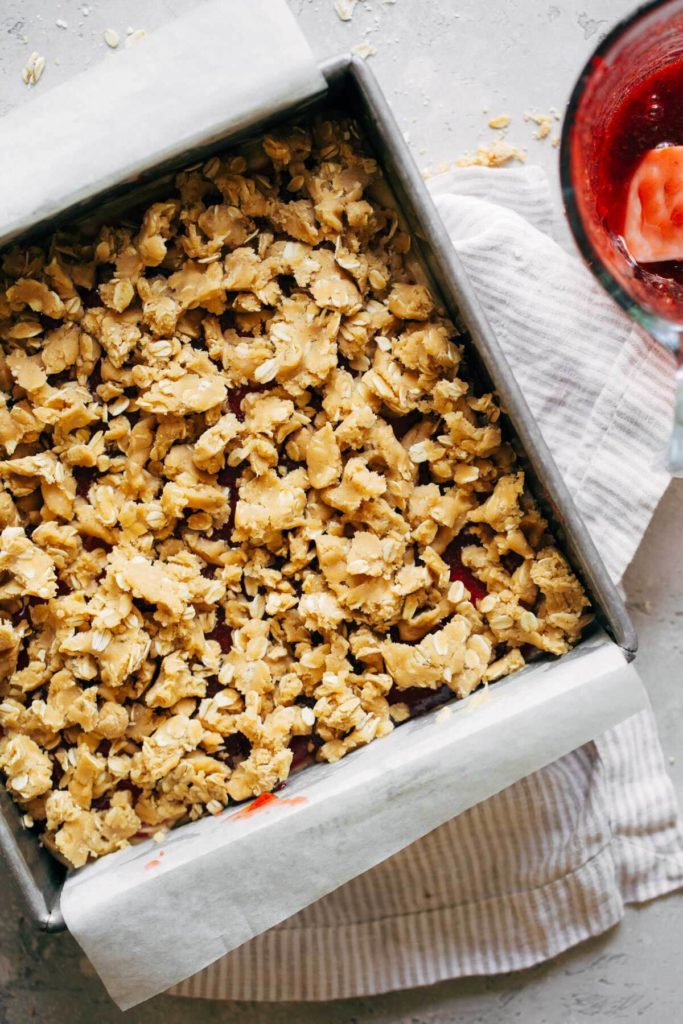 peanut butter oat crumbles on top of peanut butter and jelly bars