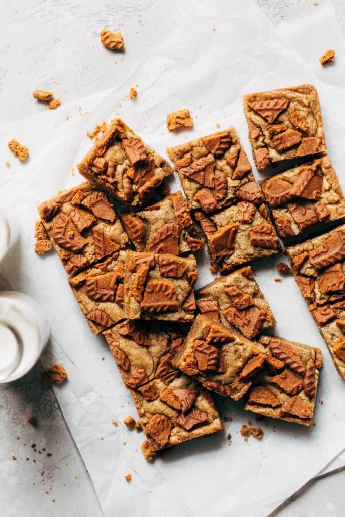 sliced blondies scattered on parchment paper