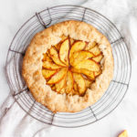Peach galette on a round wire cooling rack