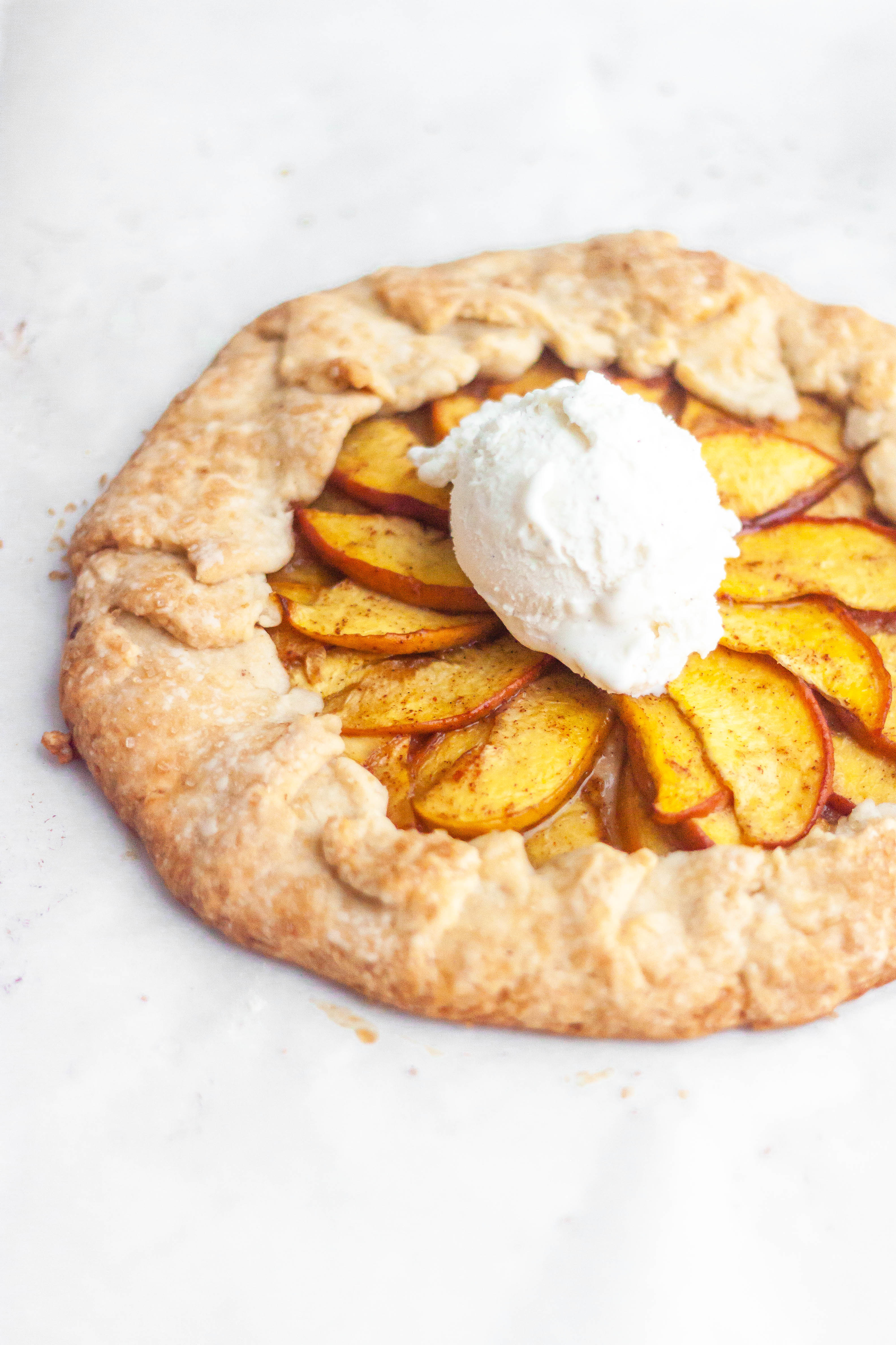 Summer peach galette with a scoop of ice cream