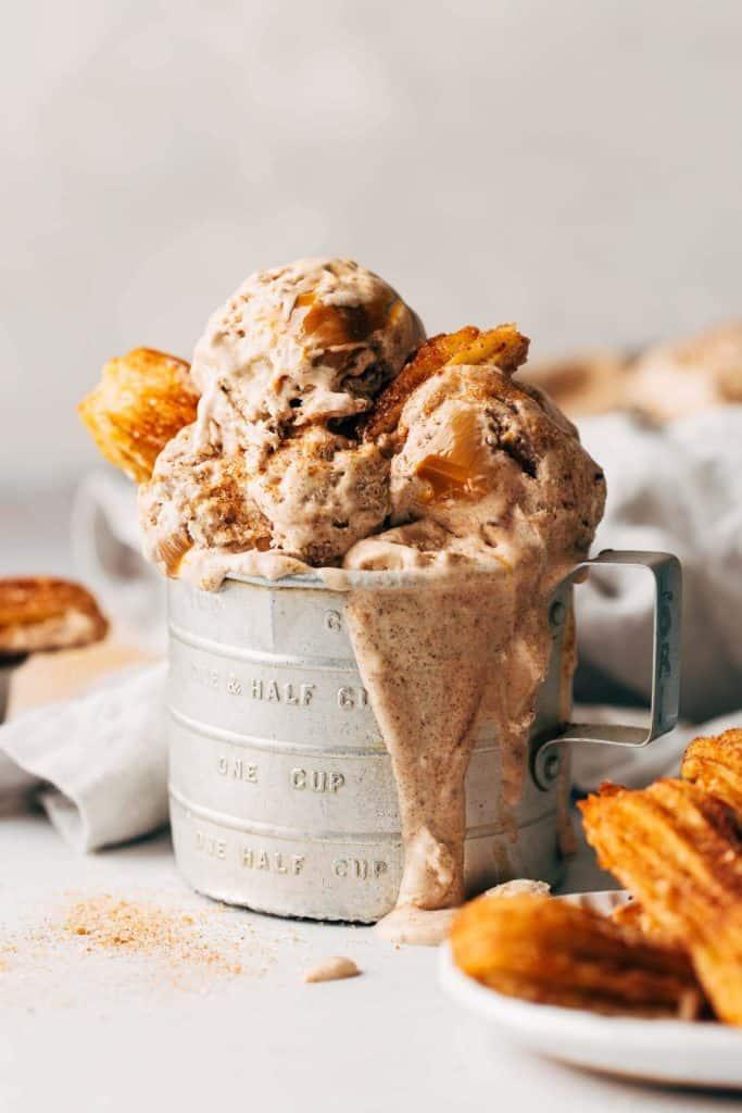 churro ice cream in an old tin measuring cup