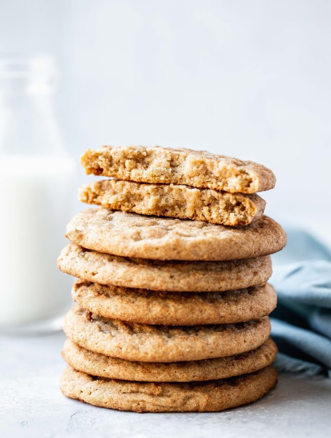 a stack of snickerdoodles with a glass of milk
