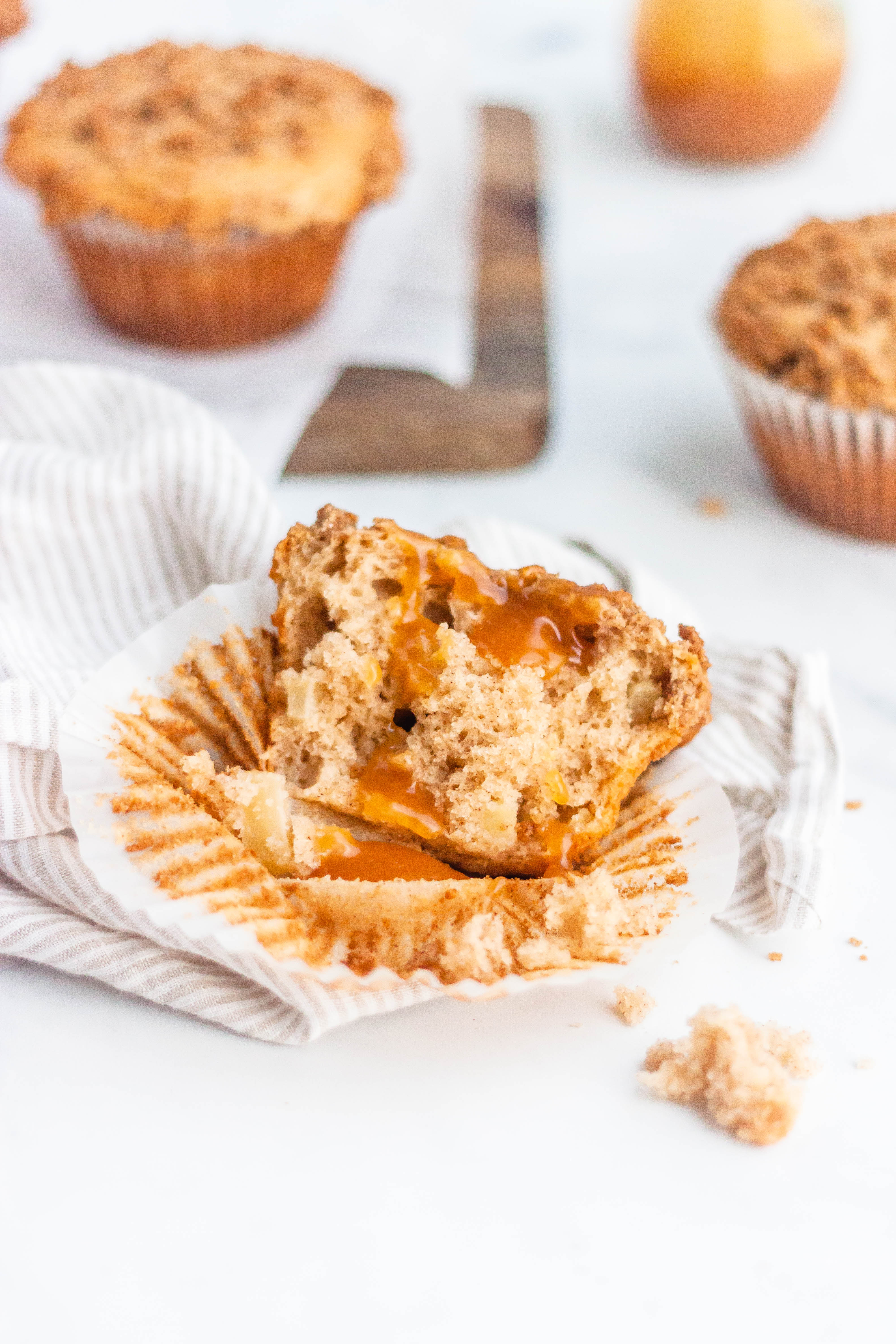 A caramel apple muffin cut in half