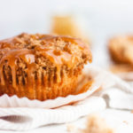 Caramel apple muffins with the caramel dripping off the edge