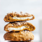 Pumpkin cheesecake cookies stacked on top of each other