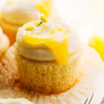 lemon curd dripping down the side of an unwrapped lemon cupcake