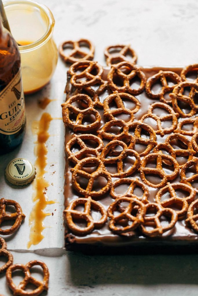 brownies with caramel and pretzels on top