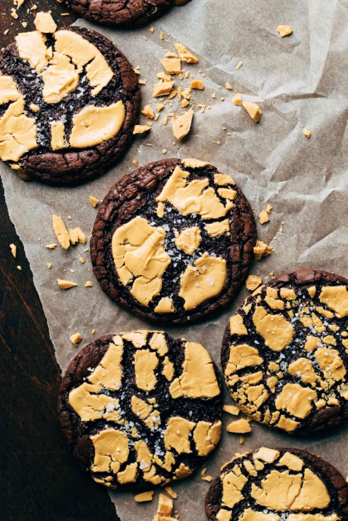 the tops of brownie cookies baked with cracked caramelized white chocolate on top