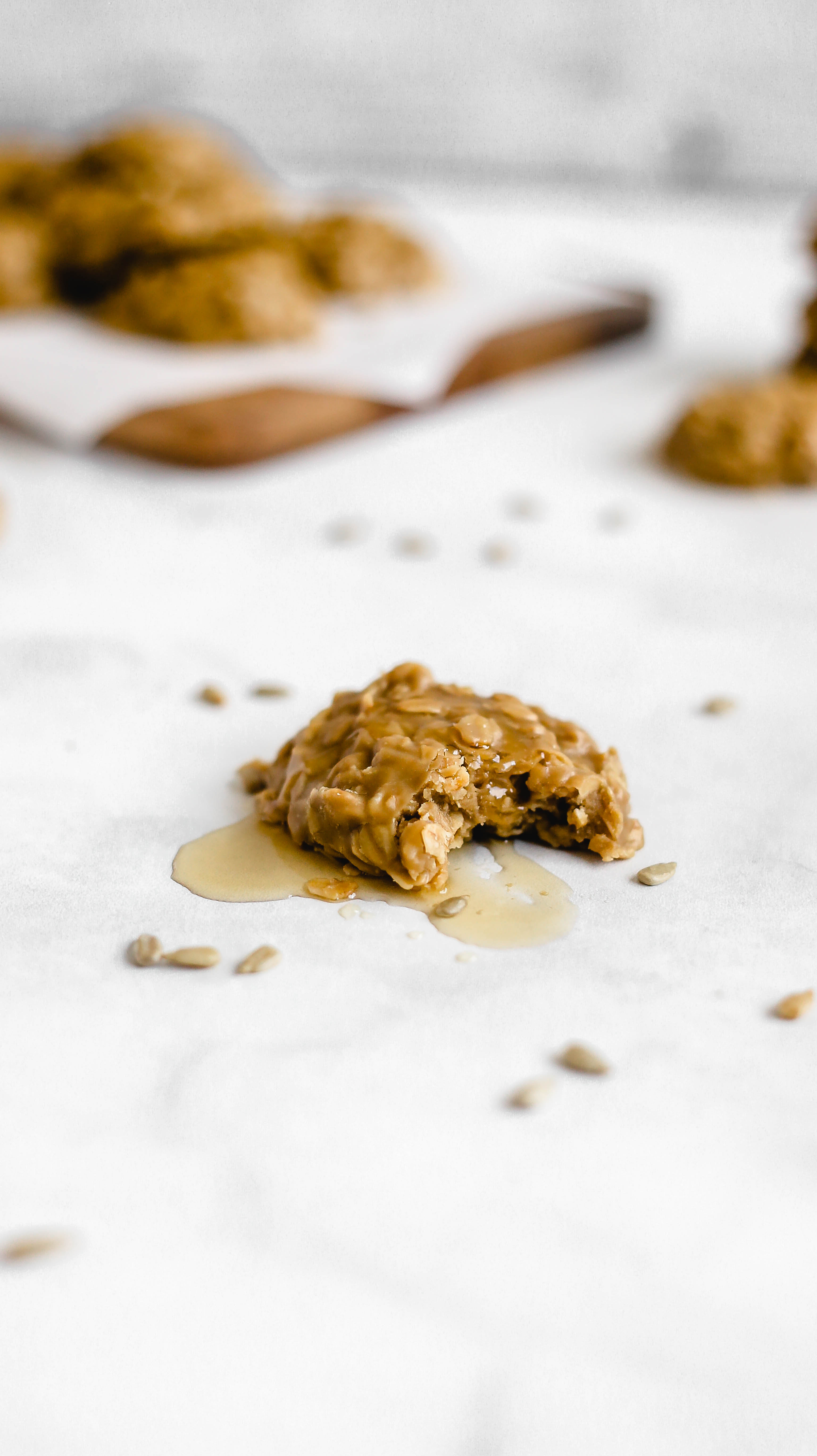 a sunflower seed butter cookie with a bite taken out