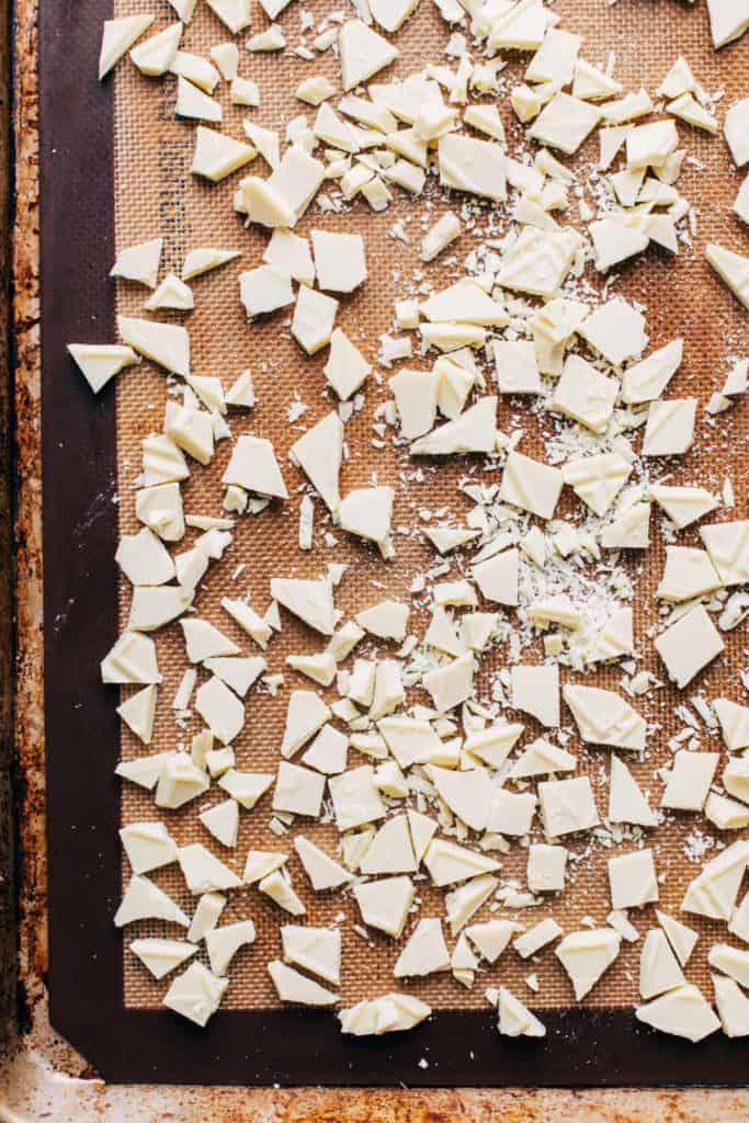 chopped white chocolate on a baking sheet