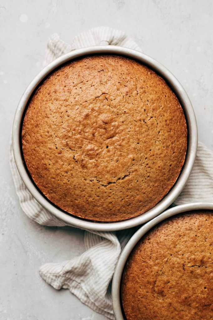 the tops of freshly baked spice cake layers