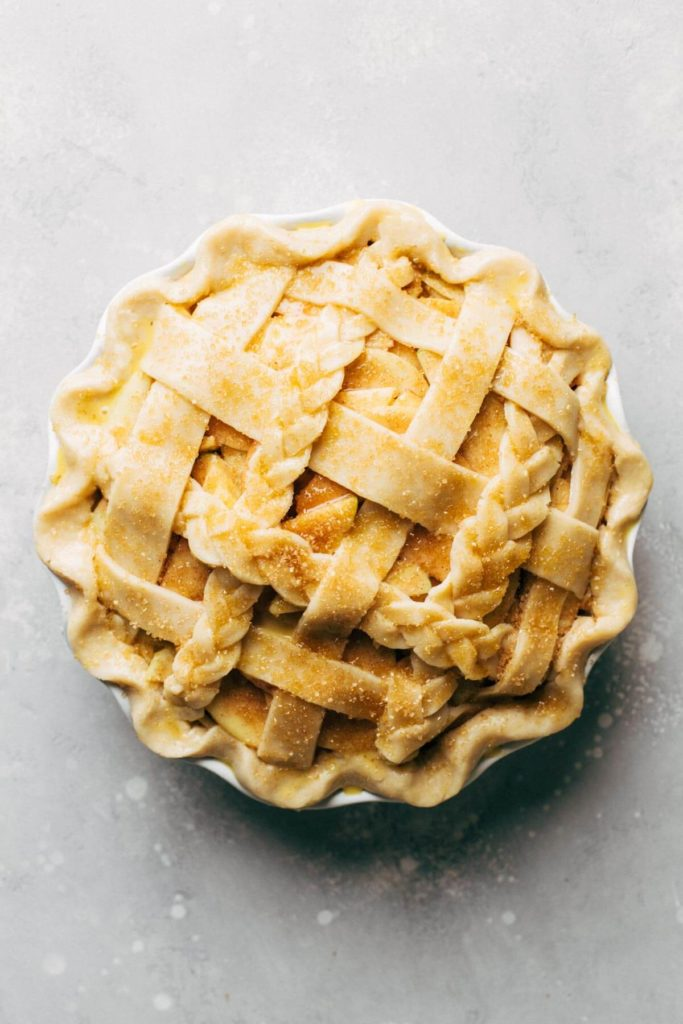the top of an apple pie that's ready to bake