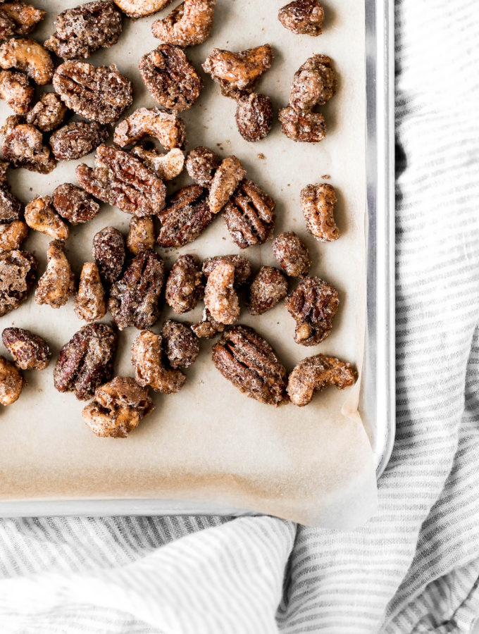 a baking tray of candied nuts