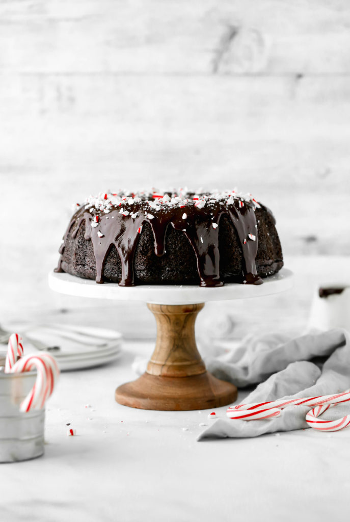 chocolate peppermint bundt cake on a cake stand