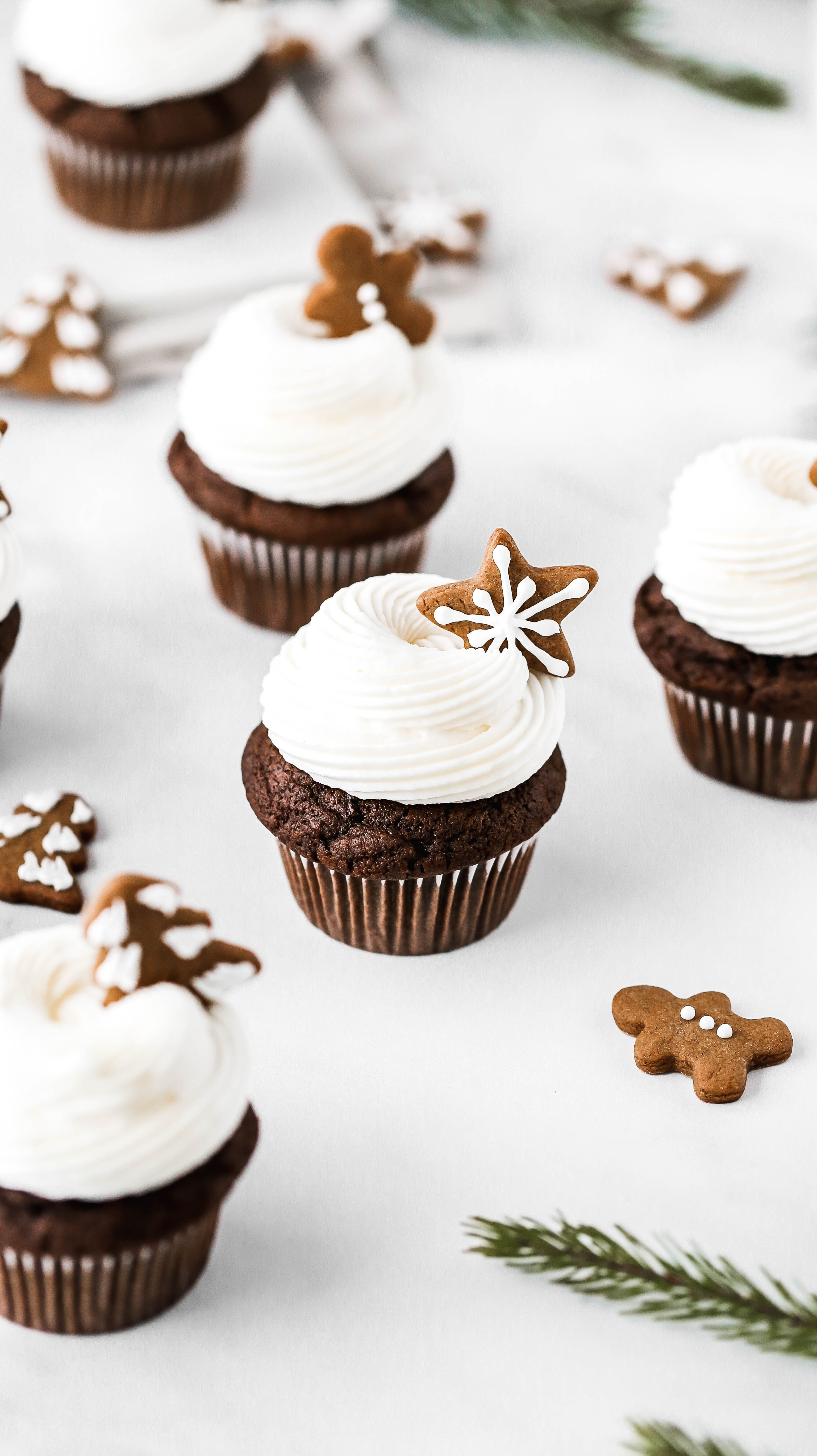 gingerbread cupcakes scattered on a marble countertop