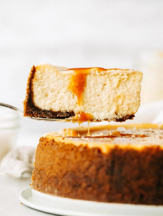 lifting out a slice of salted caramel cheescake