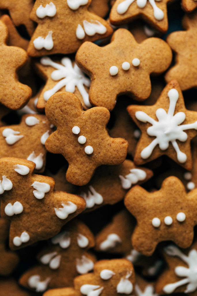 a close up of mini gingerbread cookies gathered together in a pile