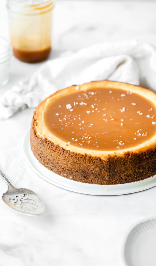 salted caramel cheesecake with a pool of homemade salted caramel on top