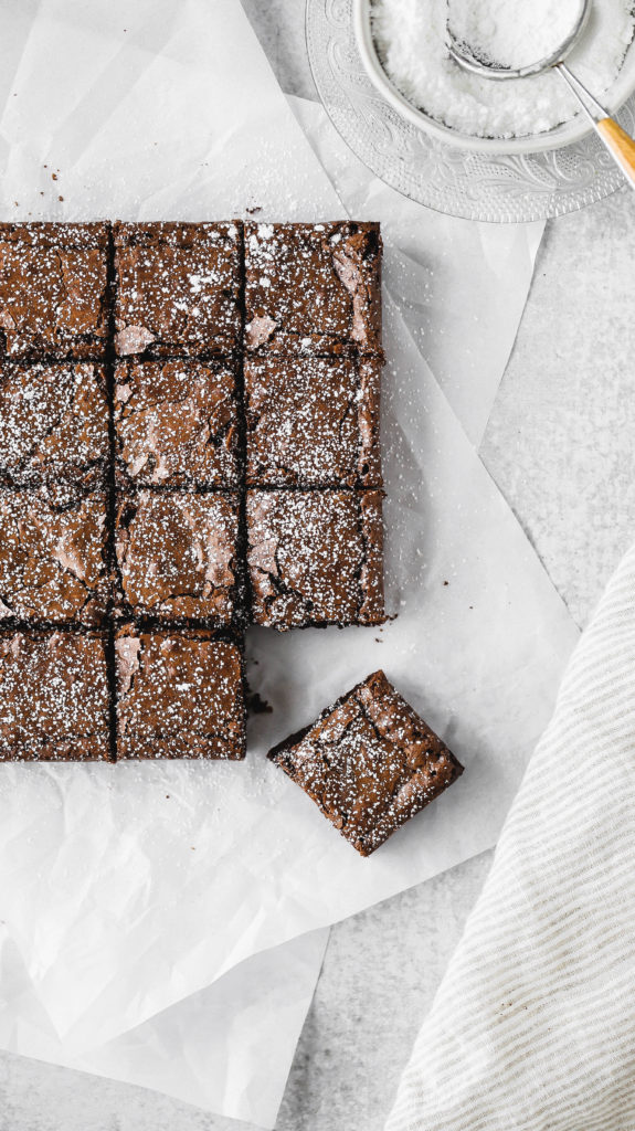 better than boxed brownies laying on a sheet of parchment paper