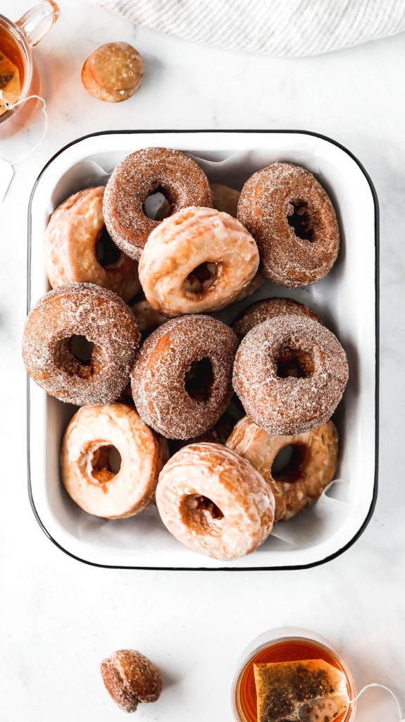 a tray full of chai spiced old-fashioned donuts
