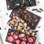 four difference homemade chocolate bars with tons of toppings