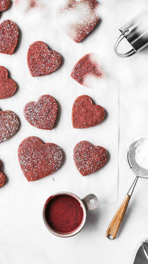 heart shaped shortbread cookies laying on parchment paper