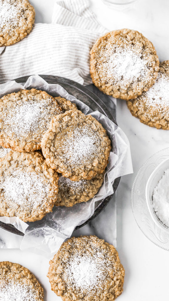 a tray of the best oatmeal cookies topped with powdered sugar