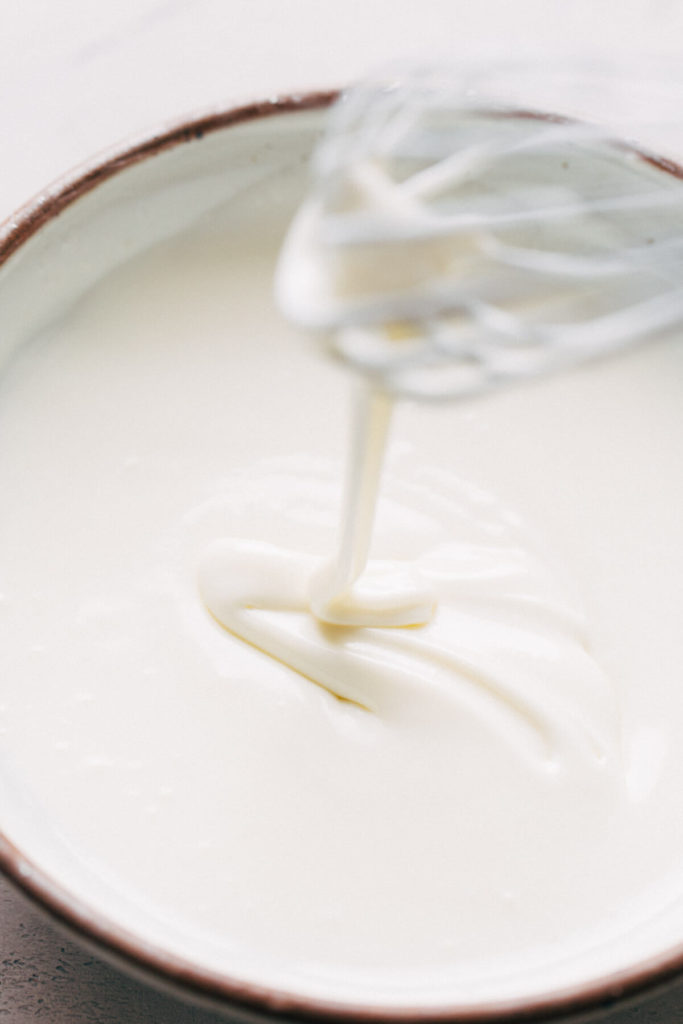 a bowl of cream cheese glaze
