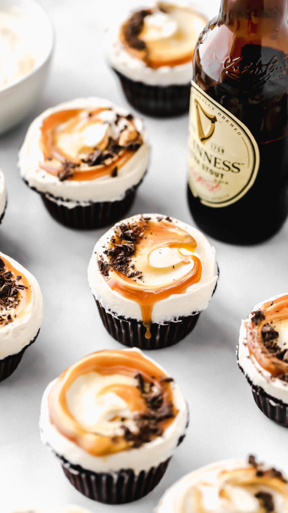 guinness chocolate cupcakes with salted caramel dripping off the frosting