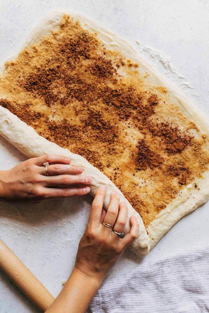 rolling up cinnamon roll dough
