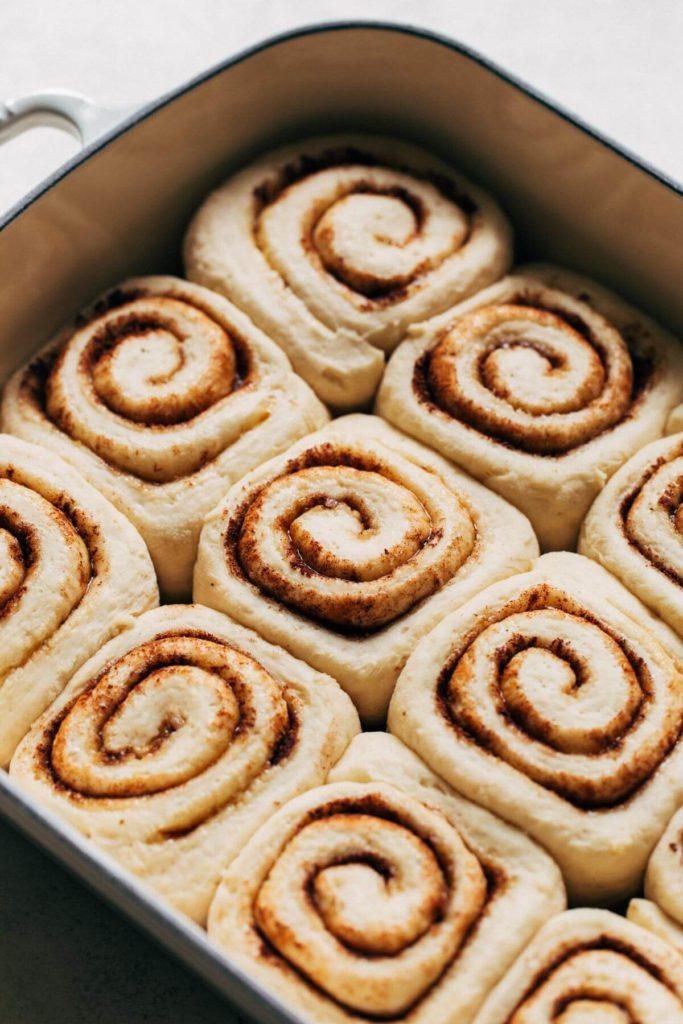 close up on proofed cinnamon rolls