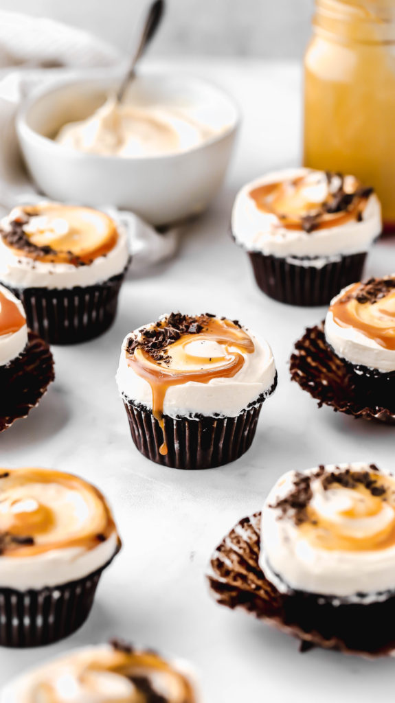 guinness chocolate cupcakes scattered throughout a marble surface