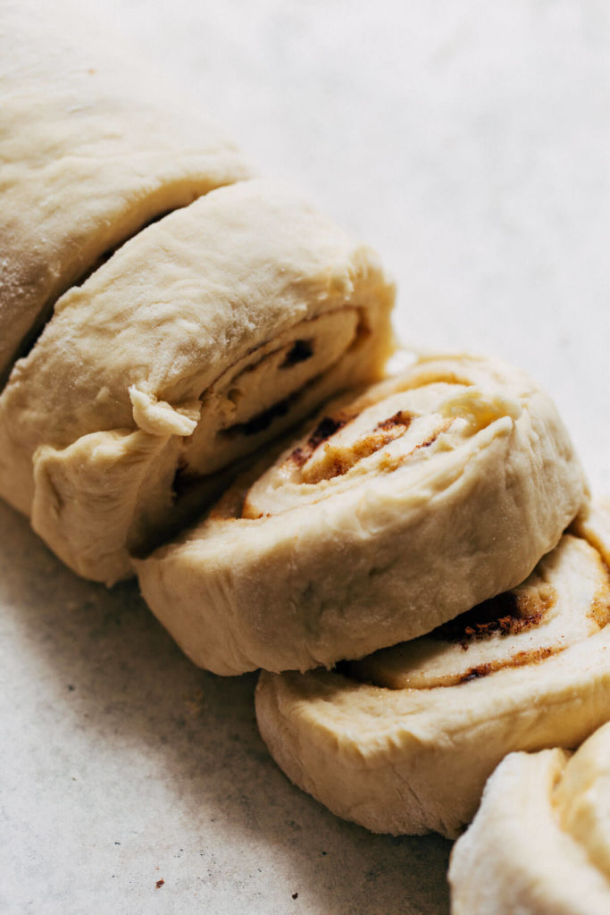 close up on sliced cinnamon roll dough