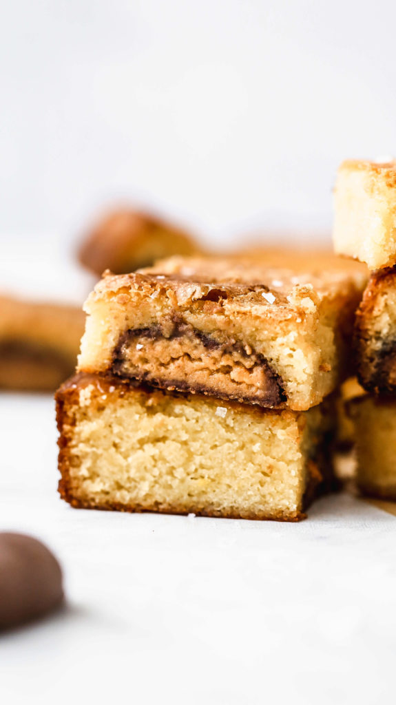 a stack of reese's stuffed white chocolate brownies