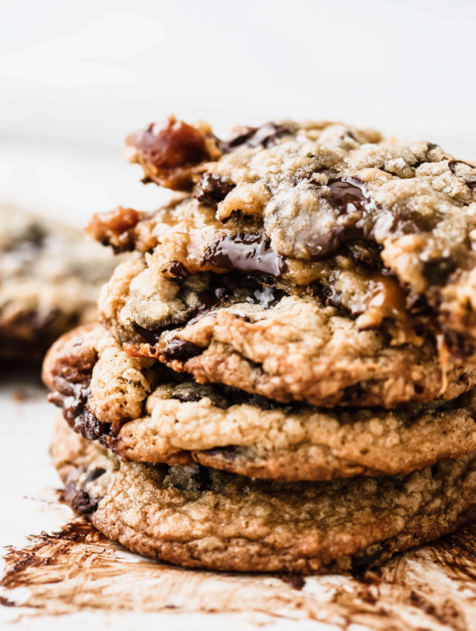 a stack of melty salted caramel chocolate chip cookies