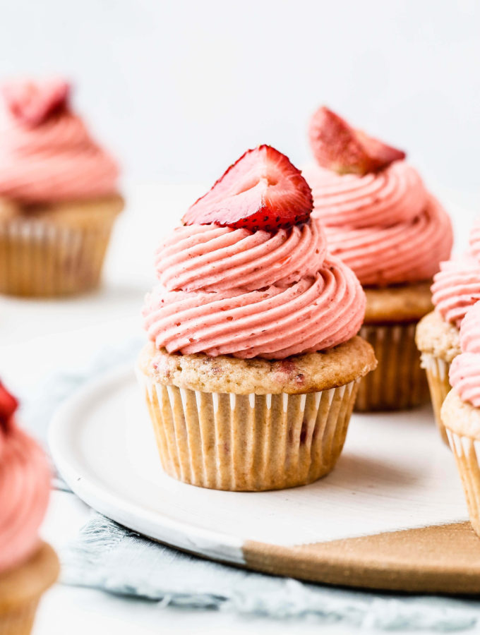 strawberry cupcakes on a ceramic plate