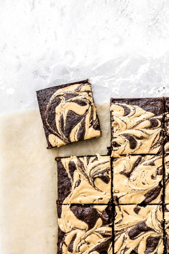 a tahini and peanut butter swirl brownie cut out from the pan