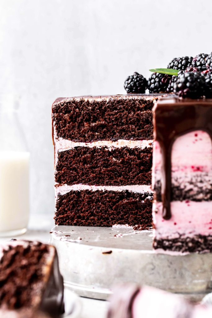 the inside slice of a blackberry chocolate cake